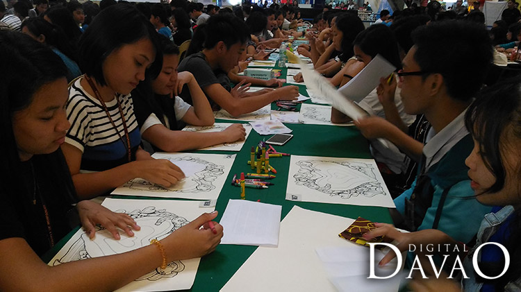Participants begin their artwork at the Art for love for art event